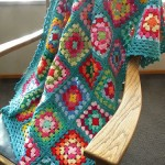 colorful and turquoise border crochet granny square blanket
