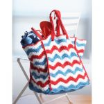 Patriotic colors are striped in a ripple pattern in this bag that's large enough to hold your beach accessories. Shown in Lily Sugar 'n Cream.