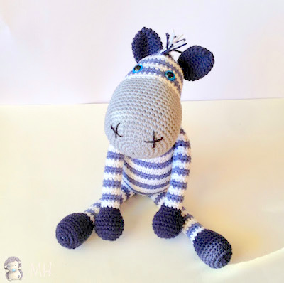 https://hubpages.com/art/Free-Crochet-Pattern-Zebra-Amigurumi-Doll