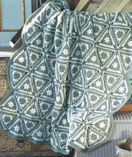 Free Crochet Pattern for an Angular Granny Throw. Crochet blanket pattern with triangles.