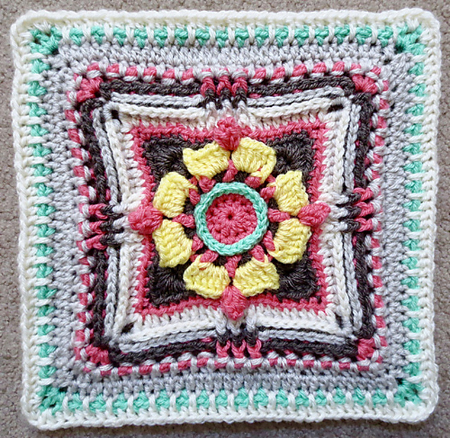 https://www.ravelry.com/patterns/library/magnolia-crossbow-afghan-square-block