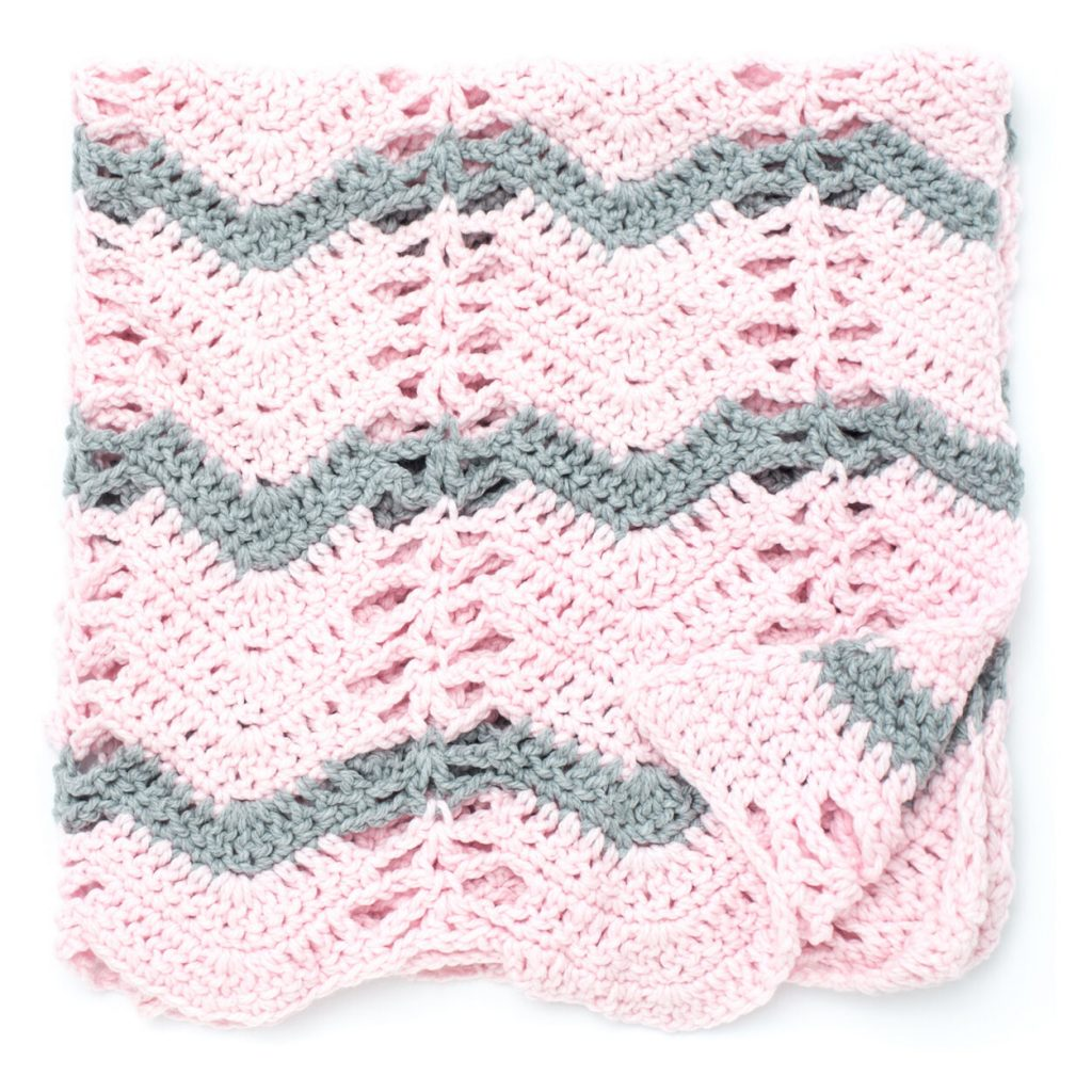 Quick and cosy crochet baby blanket with ripple and lace stitch pattern