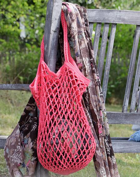 Crocheted shopping net/tote bag with chain-spaces. Piece is crocheted bottom up