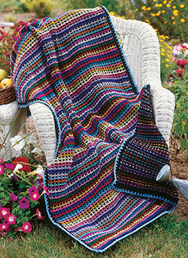 Free crochet pattern for a reversible throw with a rainbow theme