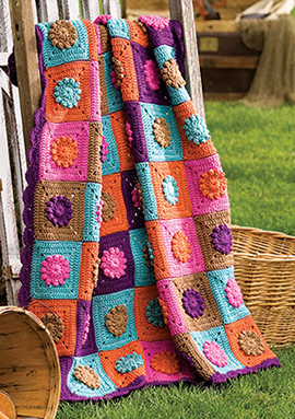 Solid squares and flowers free crochet blanket pattern