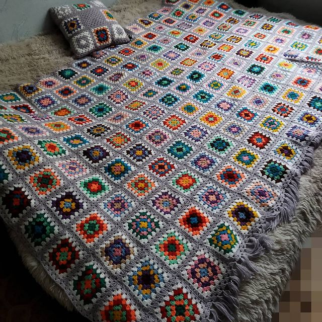 Colorful crochet squares blanket with gray border