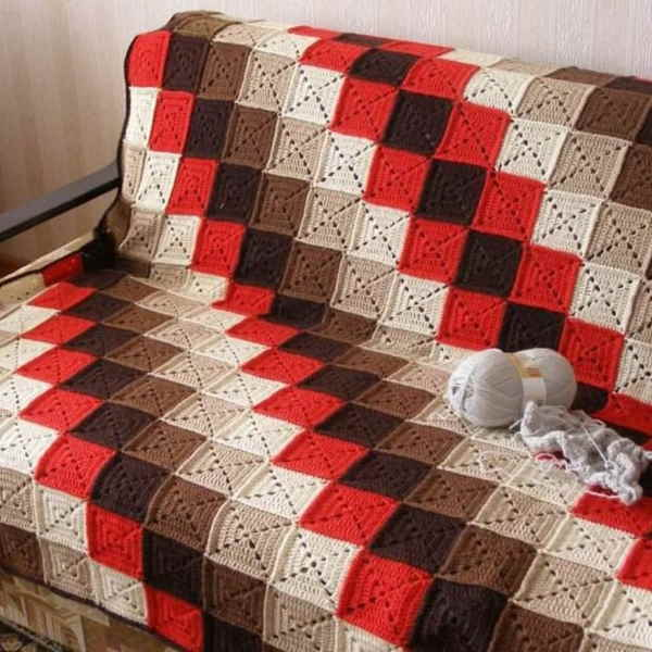 Crochet squares blanket in red and brown in diagonal stripes
