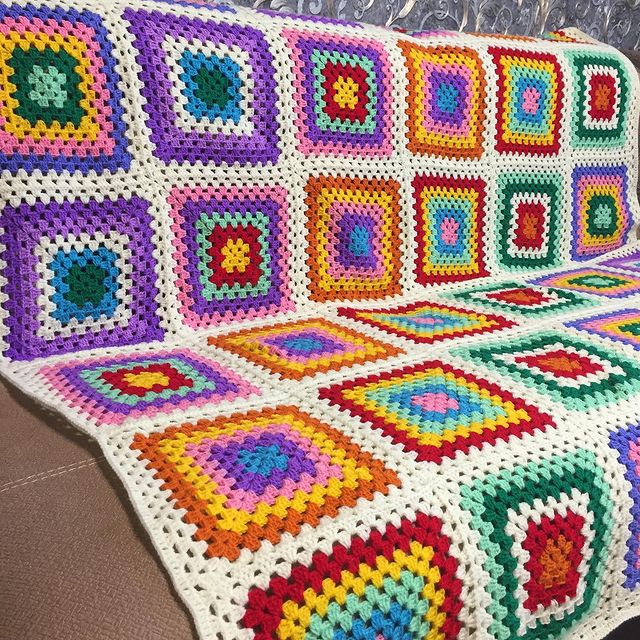 Large rainbow crochet squares with white border blanket