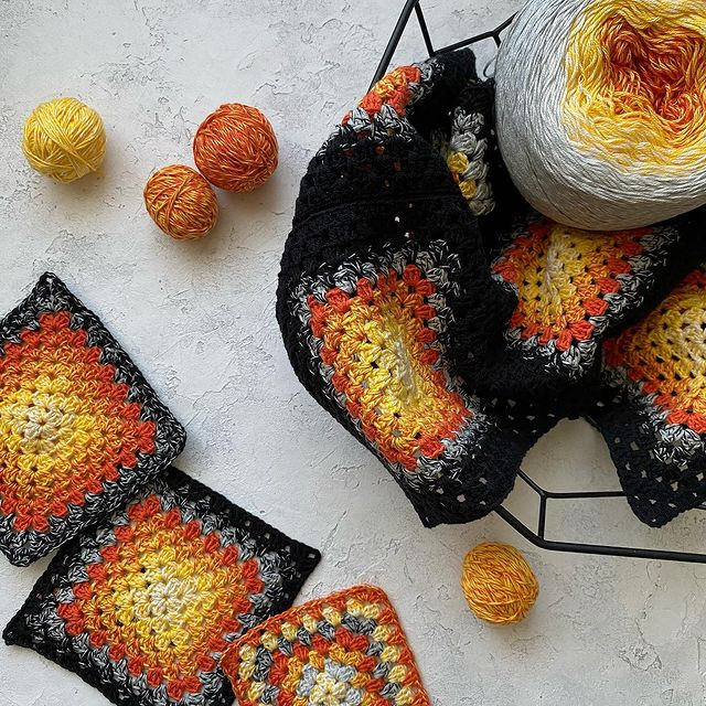orange and black granny squares crochet