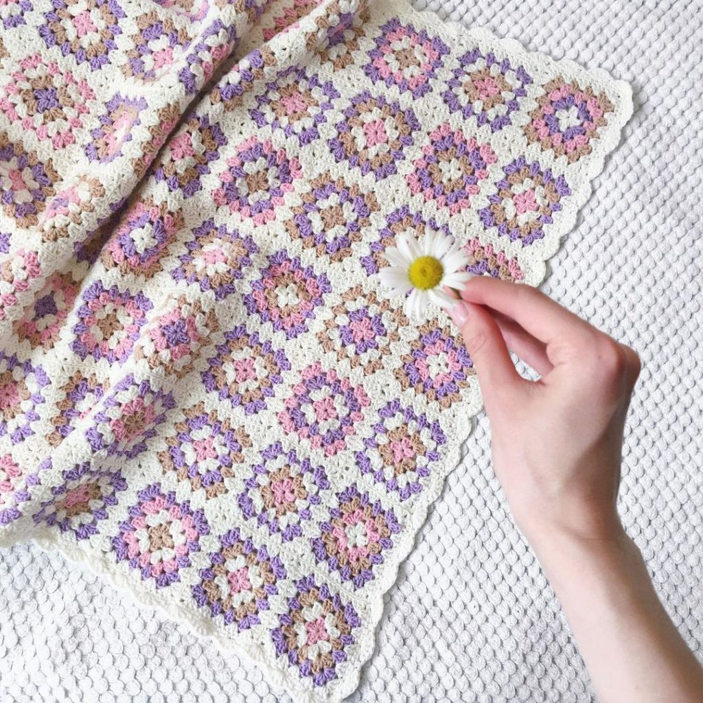 pink, purple, white and brown crochet blanket
