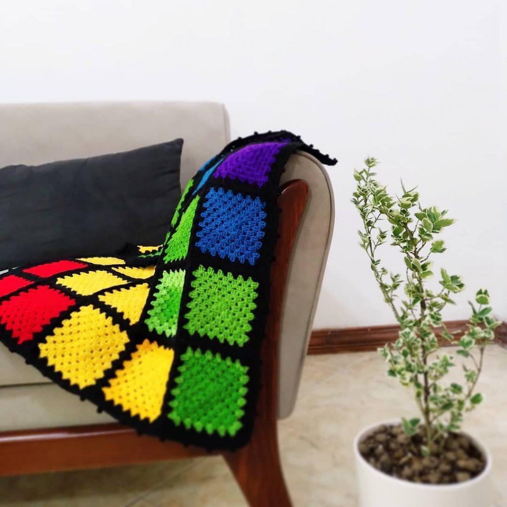 rainbow crochet granny square blanket with black border